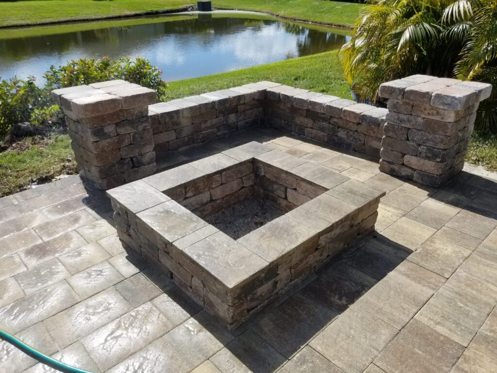 outdoor fire pit near a lake