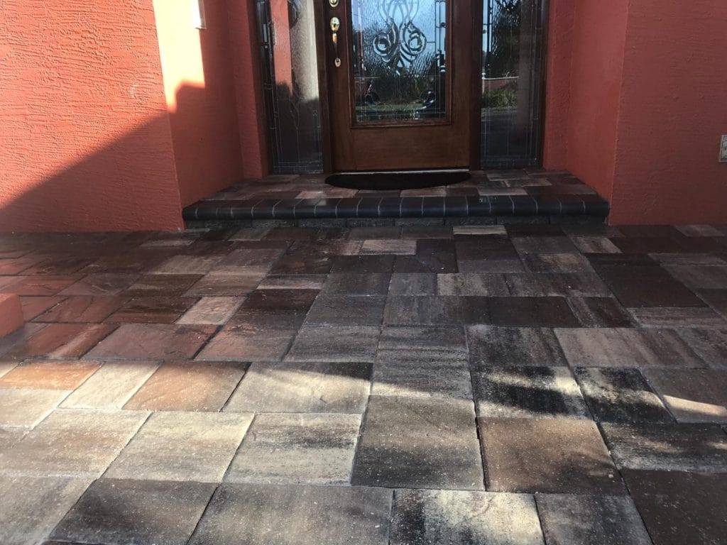 Front door patio with grey pavers recently sealed