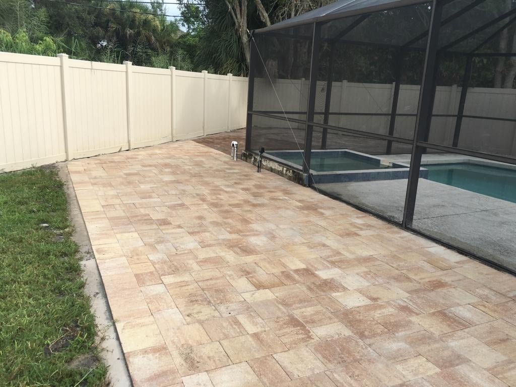 Pool deck with travertine pavers installed