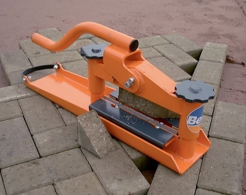 Orange brick splitter on a construction site.