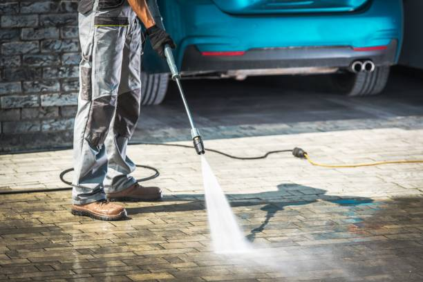 Pavers being washed with a power wash.
