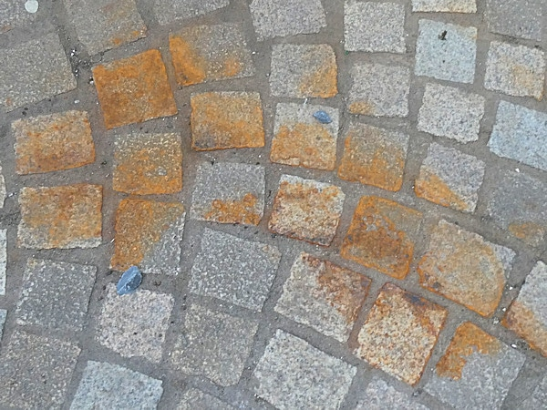 Close up of rust stains on stone pavers.