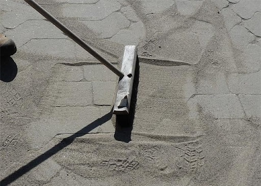 Polymeric sand installation on pavers